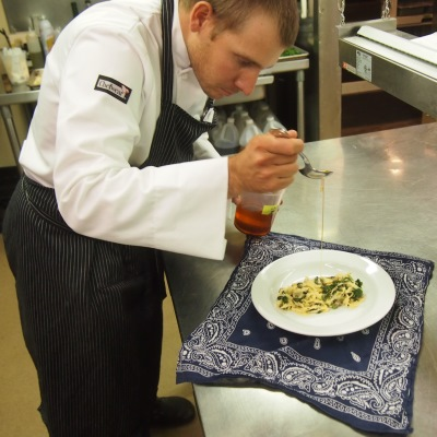 Chef JT prepares a pasta dish at Vista Verde Guest Ranch near Steamboat Springs Colorado.