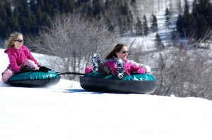 kids sledding on their winter vacation