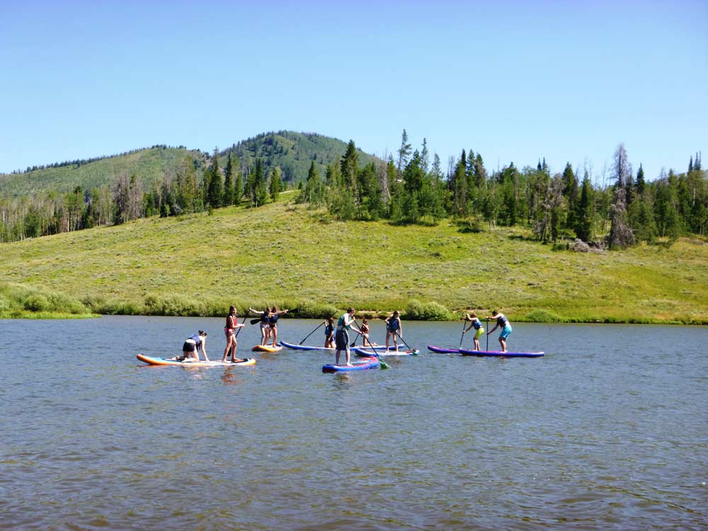 teens-paddle-boarding-on-Colorado-vacation2