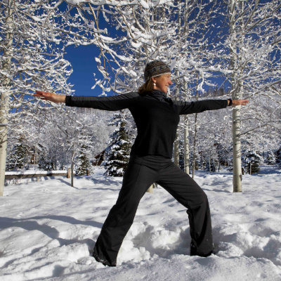 Yoga doesn't have to stop when the seasons change! Vista Verde Ranch's yoga instructor, Kelli, demonstrates some moves in the snow!