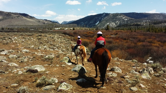 Springtime in Colorado means trail rides amidst melting snow at Vista Verde Guest Ranch