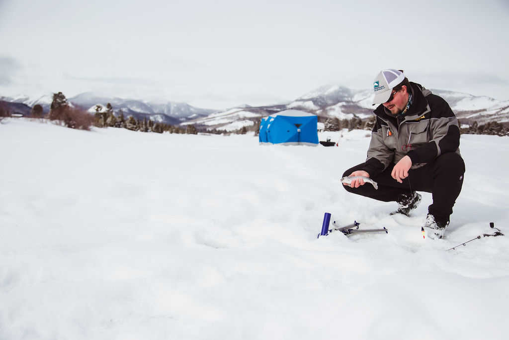 ice fishing on Steamboat Lake with Vista Verde Ranch guide