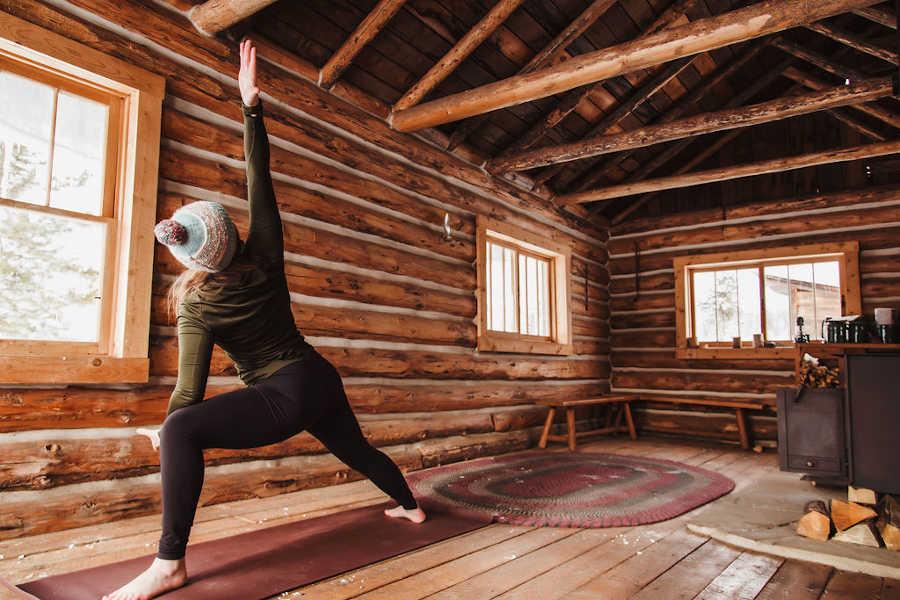 yoga in a rustic cabin at a Colorado resort in winter