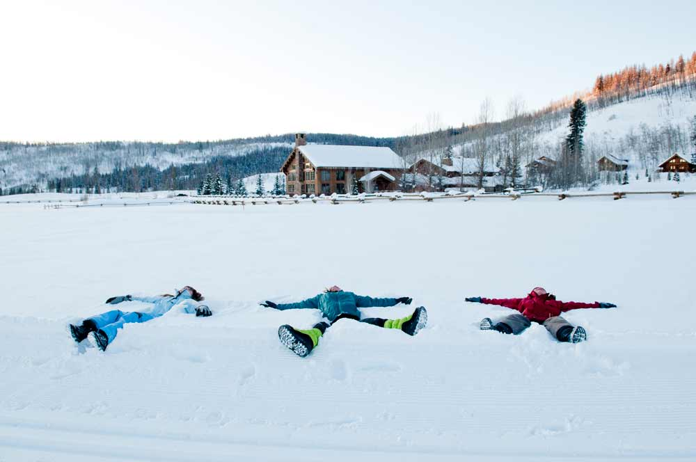 kids making snow angels at Vista Verde Ranch